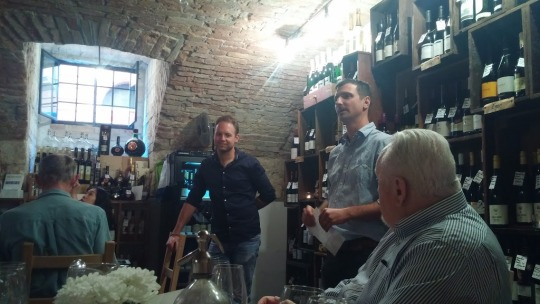 an image of a wine pairing dinner at the Tasting Table
